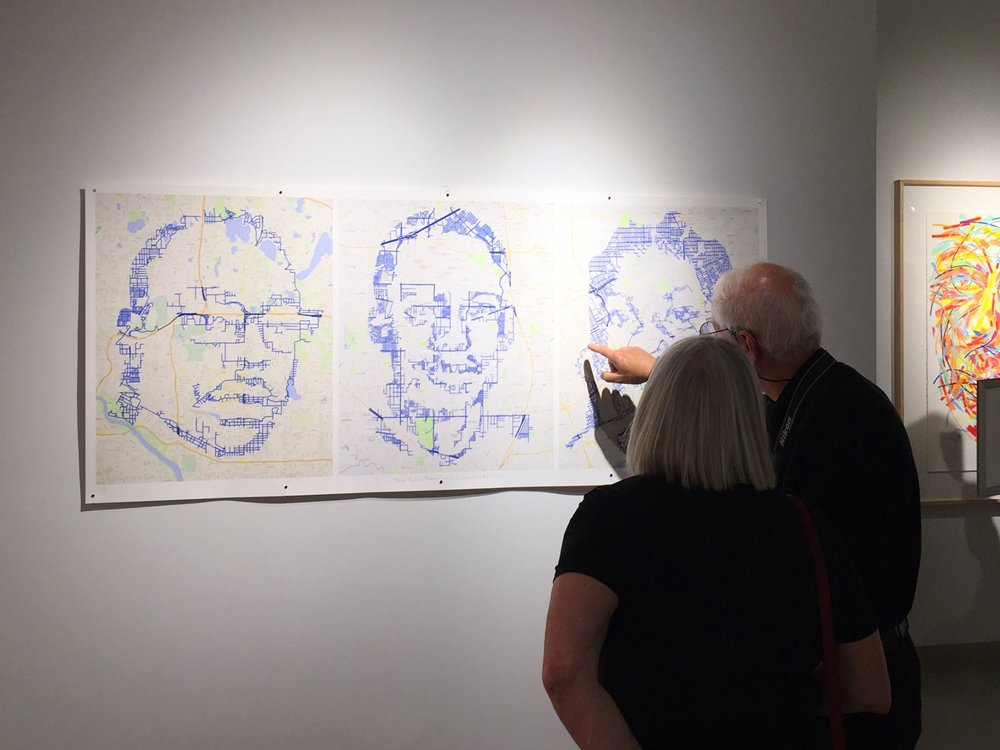 "At the Michigan Fine Arts Competition exhibition, people are following the key points of my ""Street Portraits: Philando Castile, Jordan Edwards, and Aiyana Jones,"" each drawn in one continuous line through the streets around St. Paul, Dallas and Detroit where they were killed."