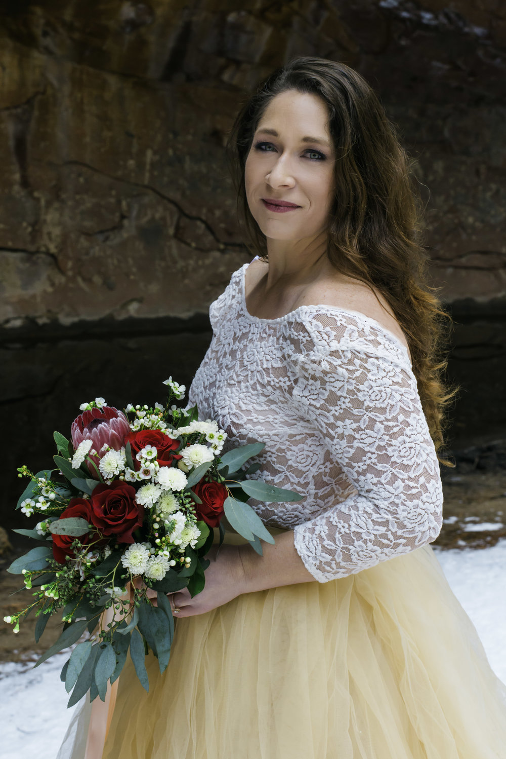 Bride in Tulle Dress with a Lace Top & Red Rose Bouquet