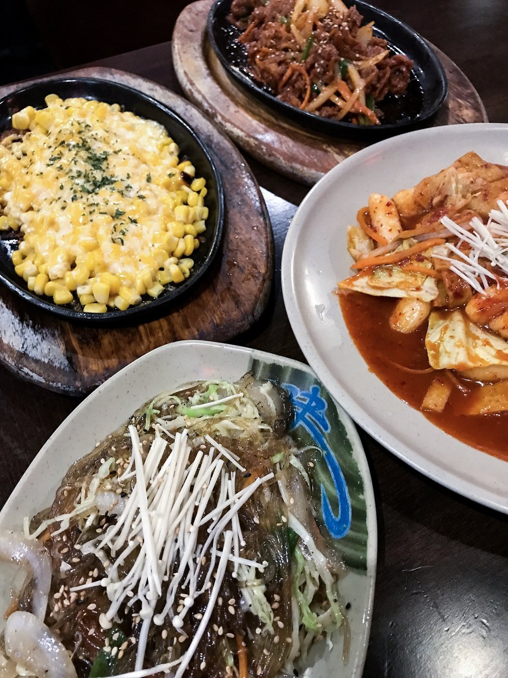 Cheesy corn, japchae, spicy pork, and tteokbokki at Cocobang.