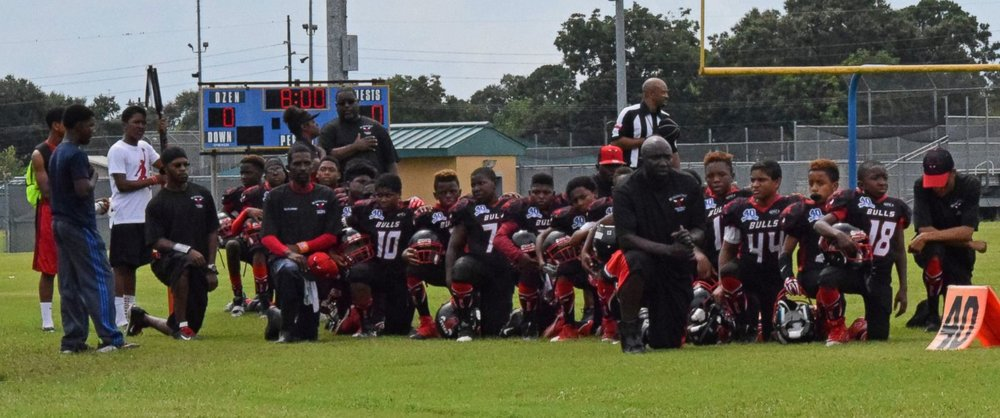 The Beaumont Bulls youth football team knelt during the national anthem before a Peewee football game and had their season suspended for their peaceful protest. (Image: ABC News)