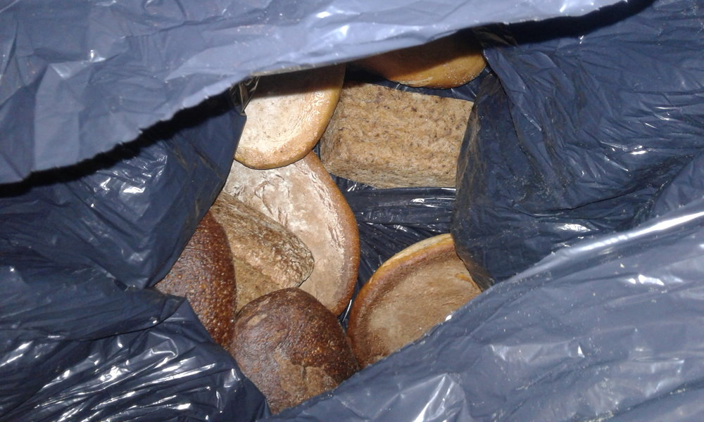 Bread that is bagged to be donated (or thrown away) at the bread shop in Newburyport, MA.