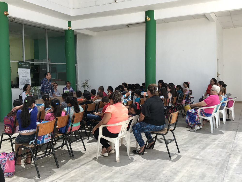 Students wait to receive their diploma for attending Villa Juárez's first summer program for children. (Photo: Elizabeth Moedano)