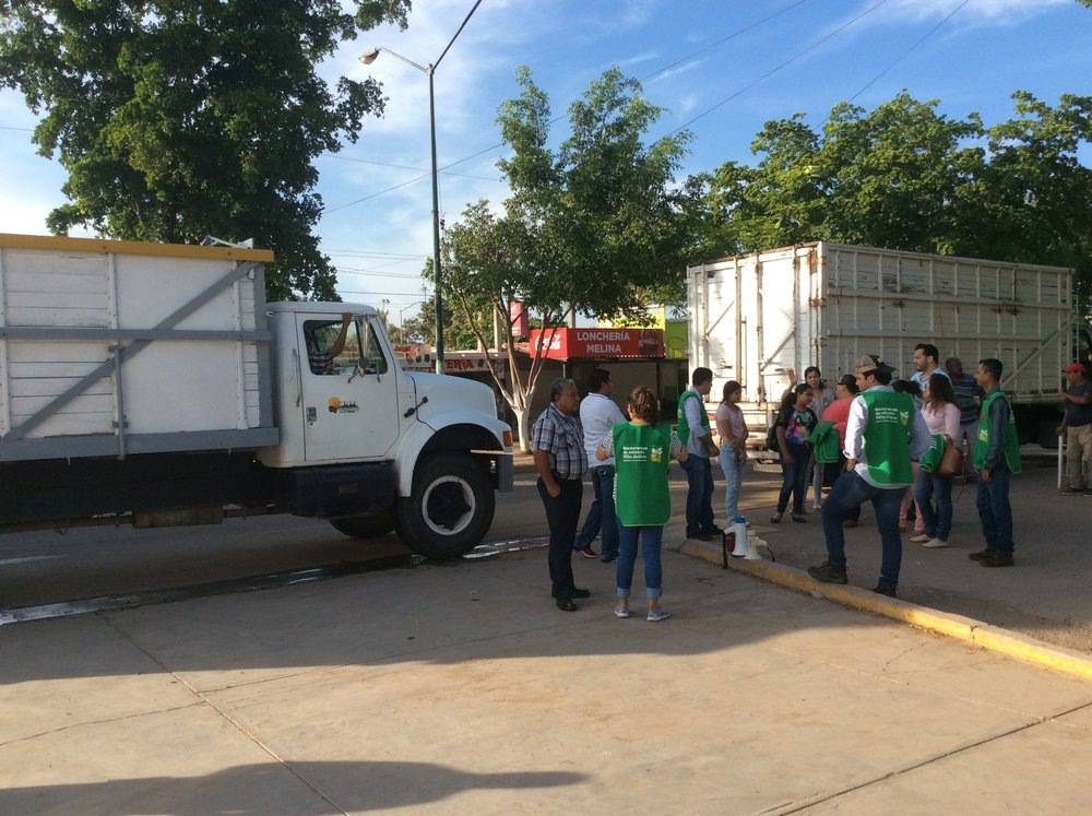 Volunteers gather in front of trucks donated by the Cárdenas Foundation (Photo: Savannah Crowley)