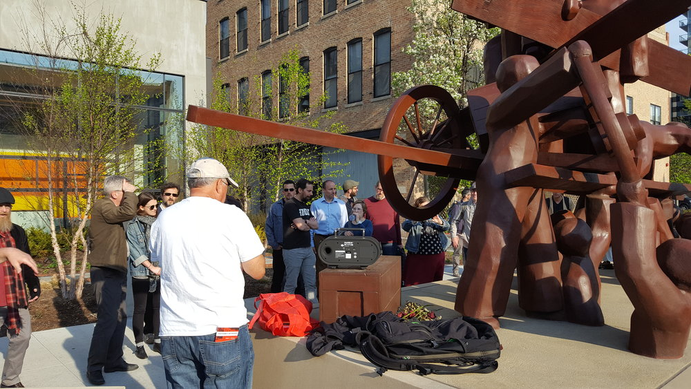 Labor activist and tour guide Larry Spivack speaks to Union of Democratic Communications conference-goers at the Haymarket Memorial in downtown Chicago.