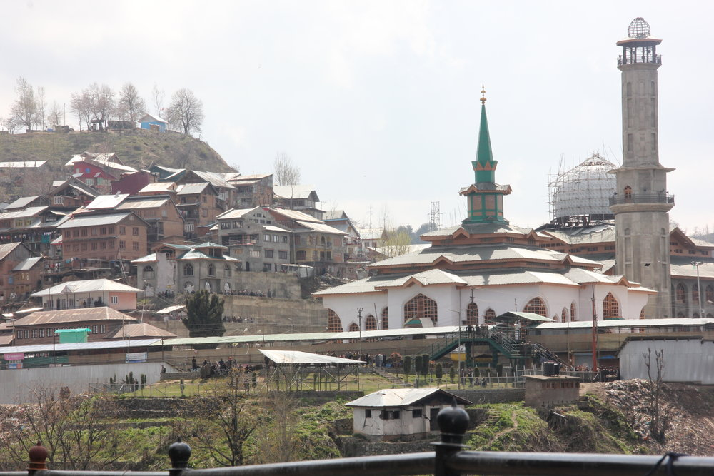 The newly constructed shrine and houses in Charari Sharief. The town was set ablaze in 1995. Photo taken from Ifat's front yard in 2016. (Photo credit: Ifat Gazia)