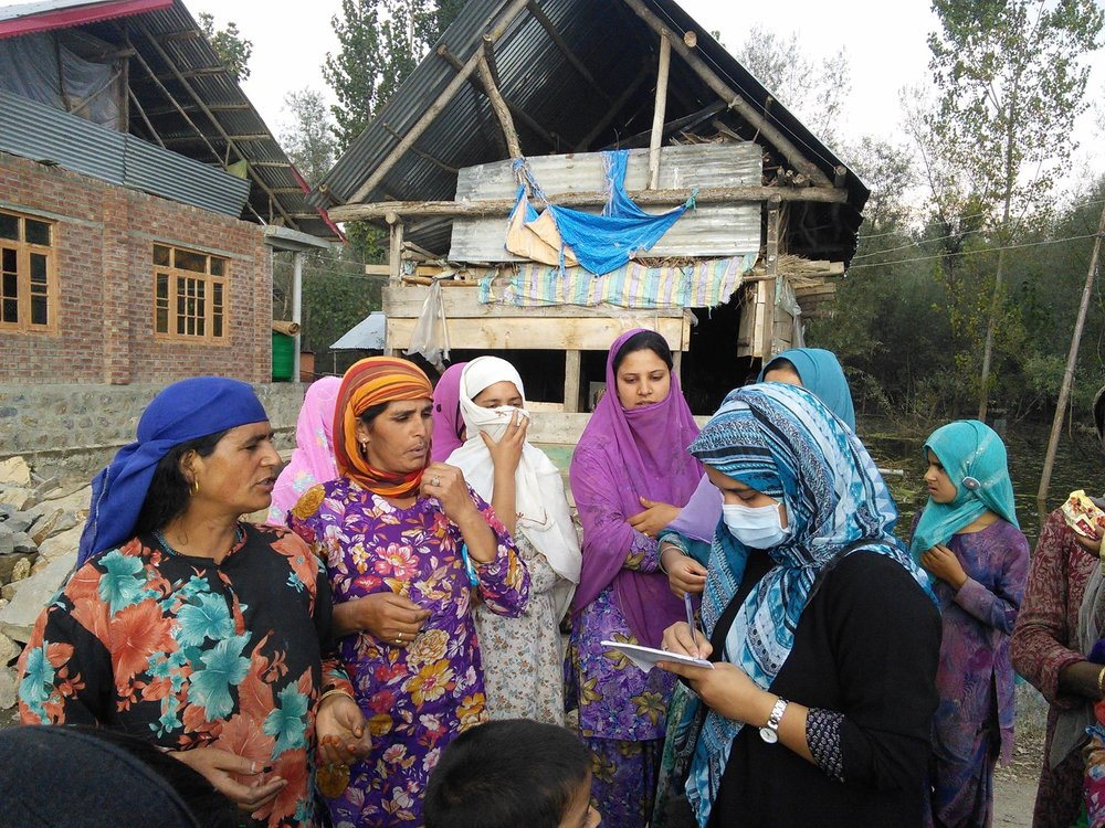 Ifat interviewing some local women in a village, north of Kashmir, during a reporting assignment in 2014. (Photo credit: Ifat Gazia)