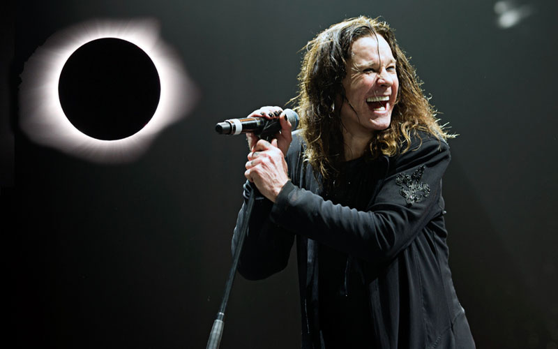 Ozzy Osbourne plays his hit song 'Bark at the Moon' just as the moon is shadowed by the sun during the full solar eclipse yesterday