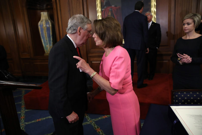 Nancy Pelosi and Mitch McConnell embracing in mutual sympathy on Capitol Hill.