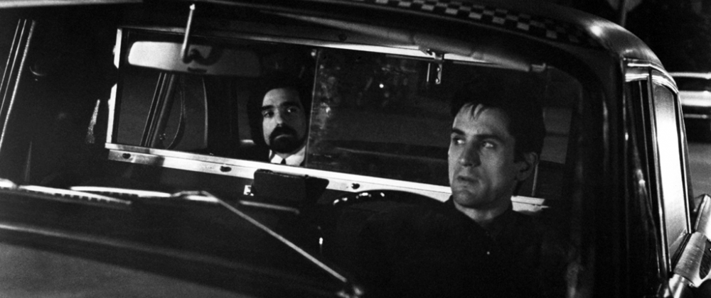 Robert DeNiro (front) as Travis Bickle in director Martin Scorsese's 1976 film  Taxi Driver