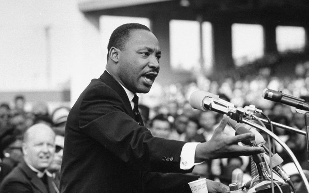 Martin Luther King Jr. at a speech in the 60s. King wrote extensively on dialectically simple and complex nature of love in his book of sermons  Strength to Love.