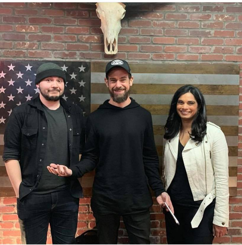 Rogan's guests (from left: Tim Pool, Jack Dorsey, Vijaya Gadde) just before the mics were turned on; clearly no one has any idea what's coming
