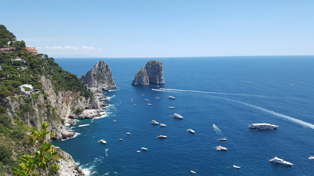 View of the Faraglioni Rocks from the Isle Capri, Italy