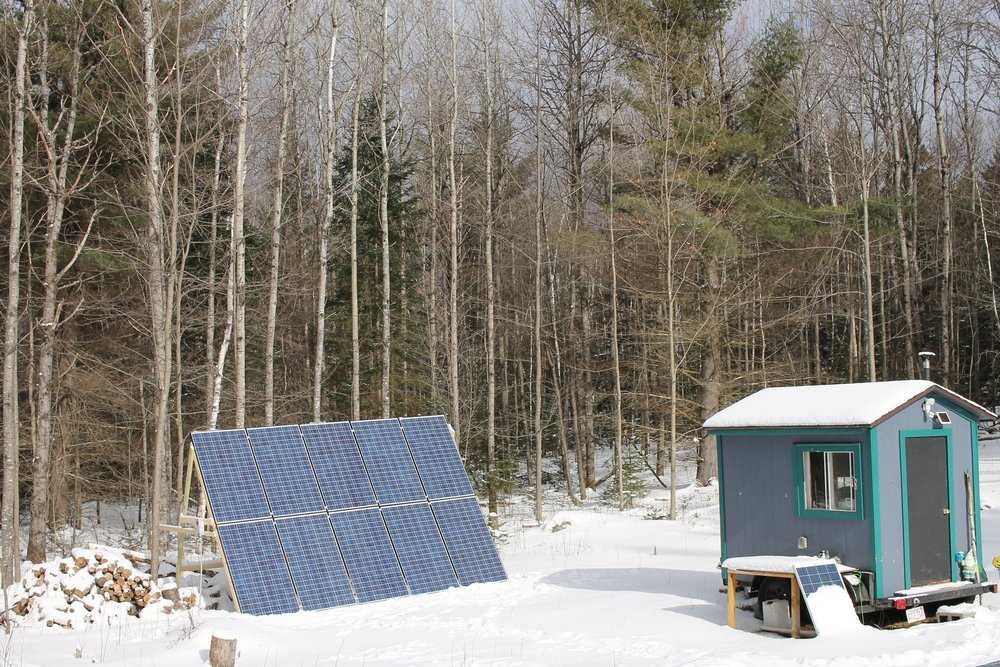 The solar panel rig outsizes the tiny guest house.