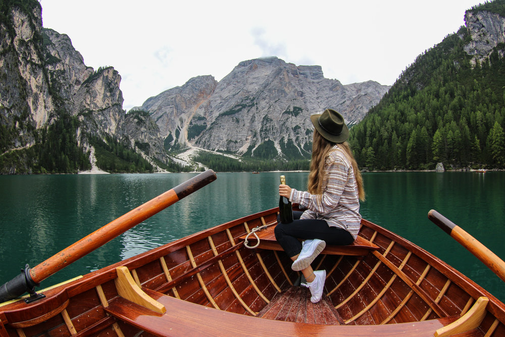 girl on a boat lake braies