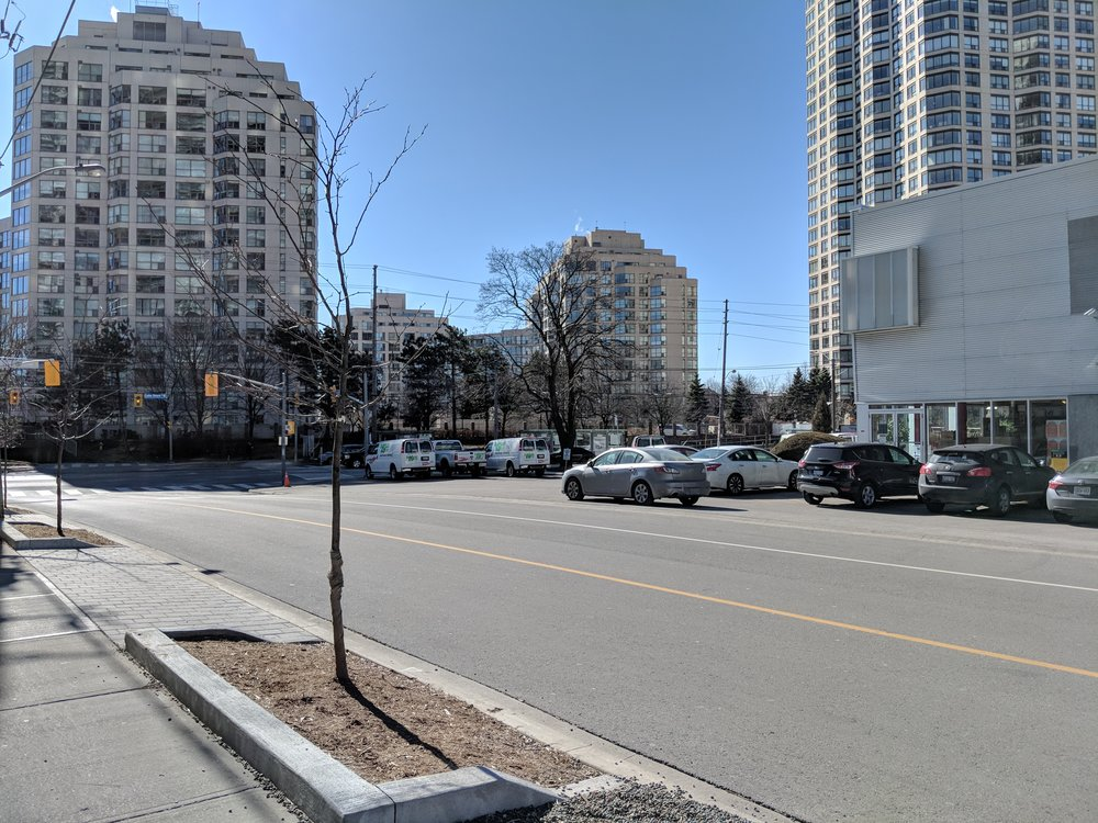 The TTC has proposed to build a streetcar loop at Lake Shore and Legion Road, roughly where the U-haul vehicles are parked in this photo. This would allow the Queen segment of the streetcar to turn around here, meaning that Humber Bay residents would not have to change at Humber Loop in order to travel to Queen West and further downtown.   If this happens I would still recommend that Lake Shore segment cars continue eastward into the city. Essentially, no one should be forced to change at Humber Loop!