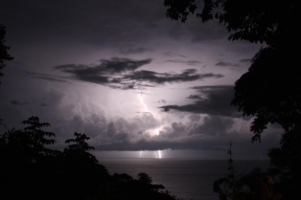 Lightning illuminates a thundercloud over the Pacific Ocean off the coast of Costa Rica.
