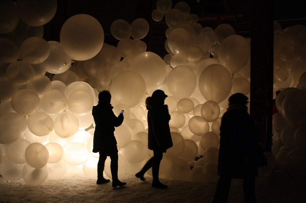 Women pass in front of an art installation in Essen, Germany, during the opening night of Ruhr 2010.