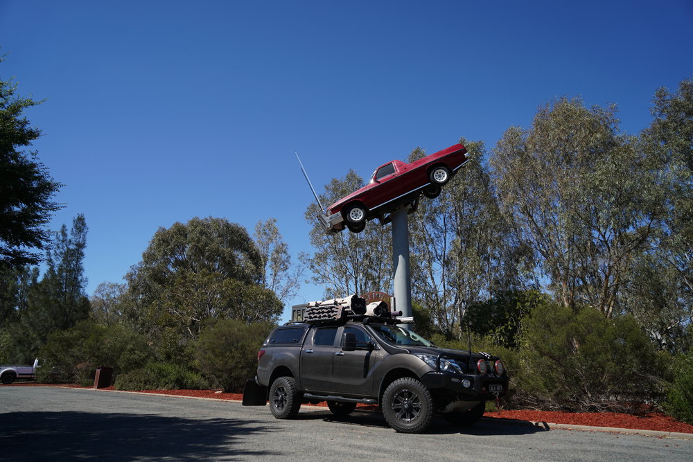 Where else can you find an old Holden ute on a 30 foot pole in the centre of town??
