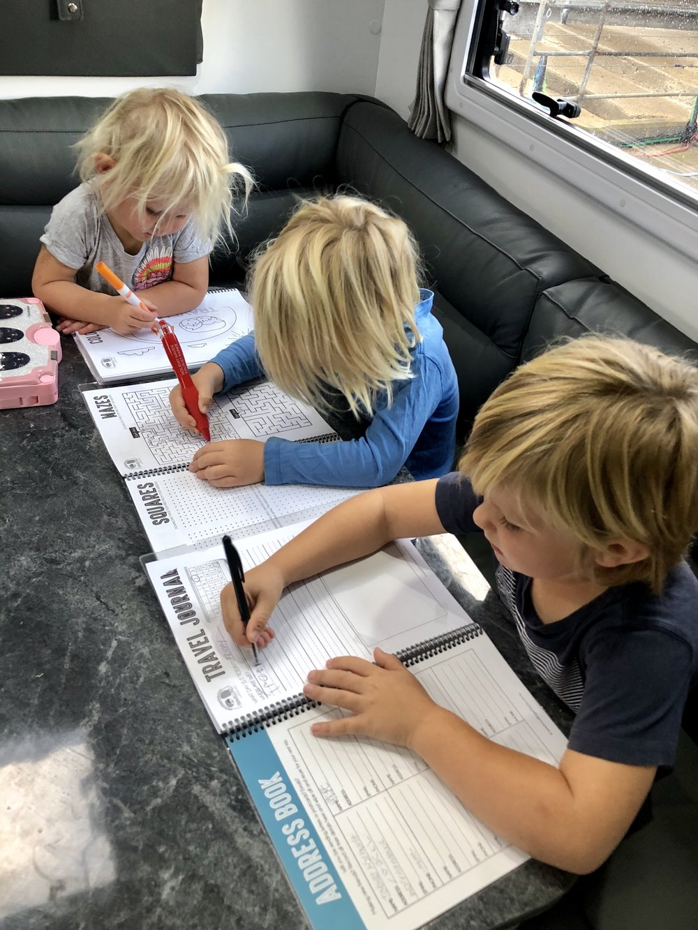 Using their Travel Journal from Caravanning With Kids.