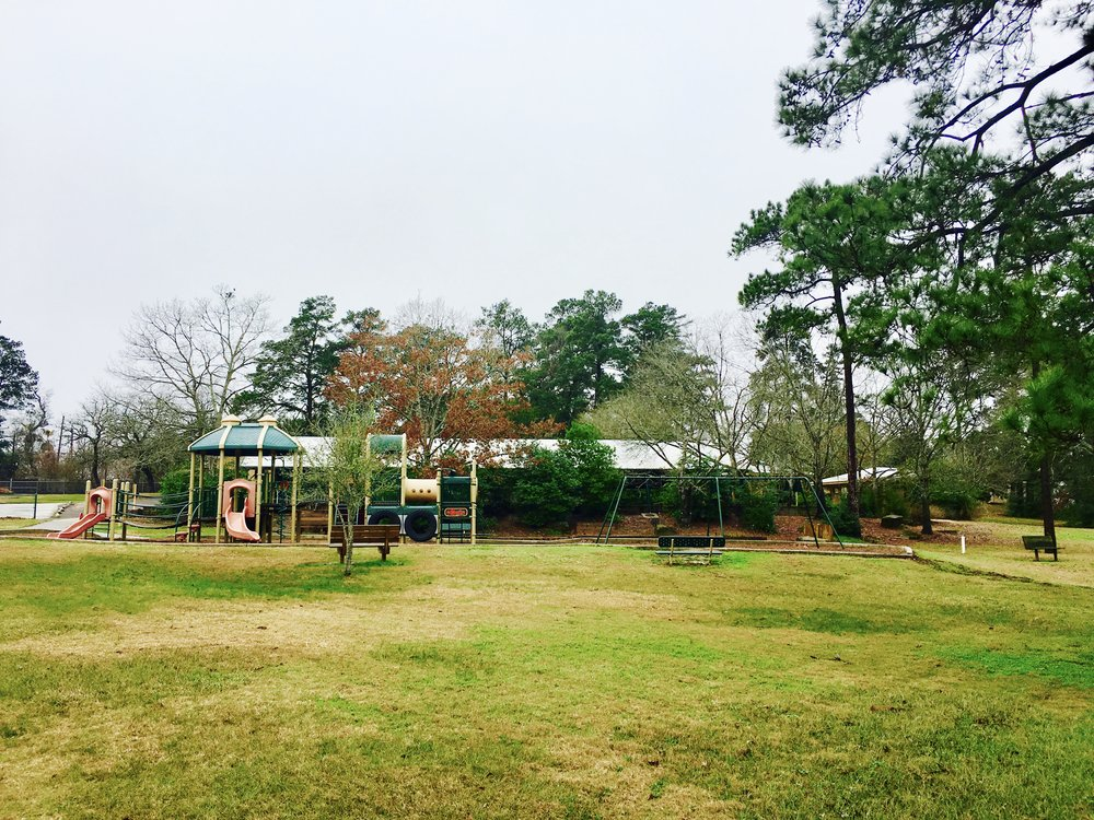 the large pavilion sits just behind one of two playgrounds.