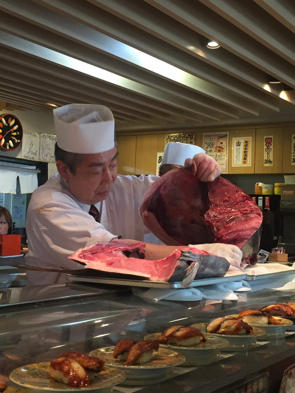 Sushi chef cuts O-Toro directly from a Tuna brought into the store only 30 minutes before
