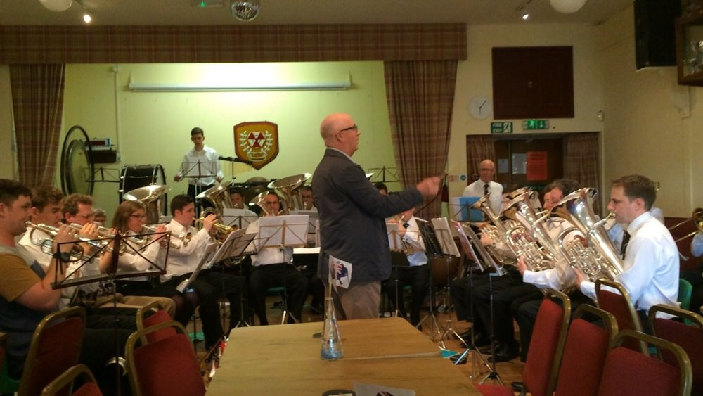 Peter Graham conducting the band in rehearsal