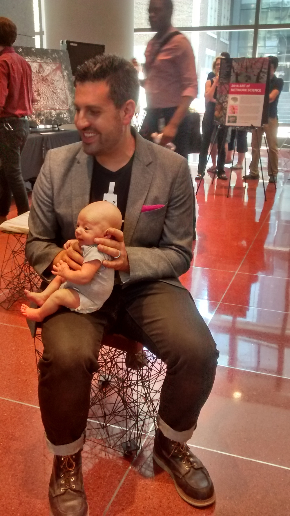 David and his son Isaac at a recent opening.