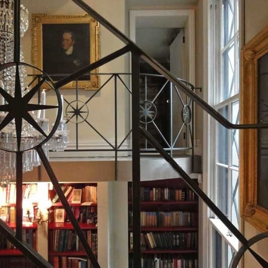 A LIBRARY IN FULHAM Two terraced houses put together, with a double-height library