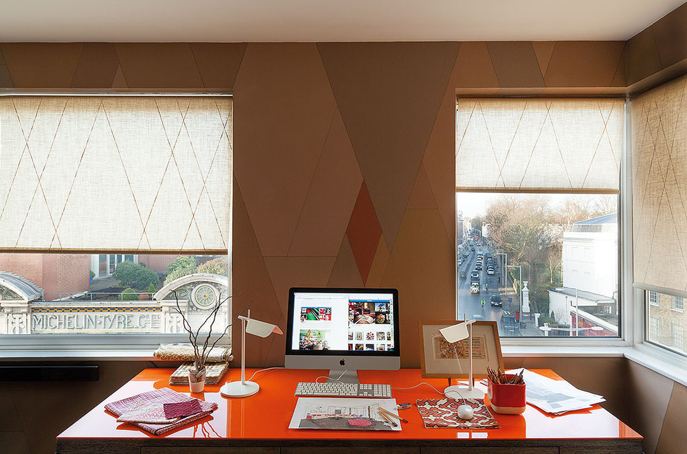 DESK     The view from my orange perspex-topped desk, across to the Michelin building and the Fulham Road. I painted the cheap linen roller blinds with white lines echoing the wall design.