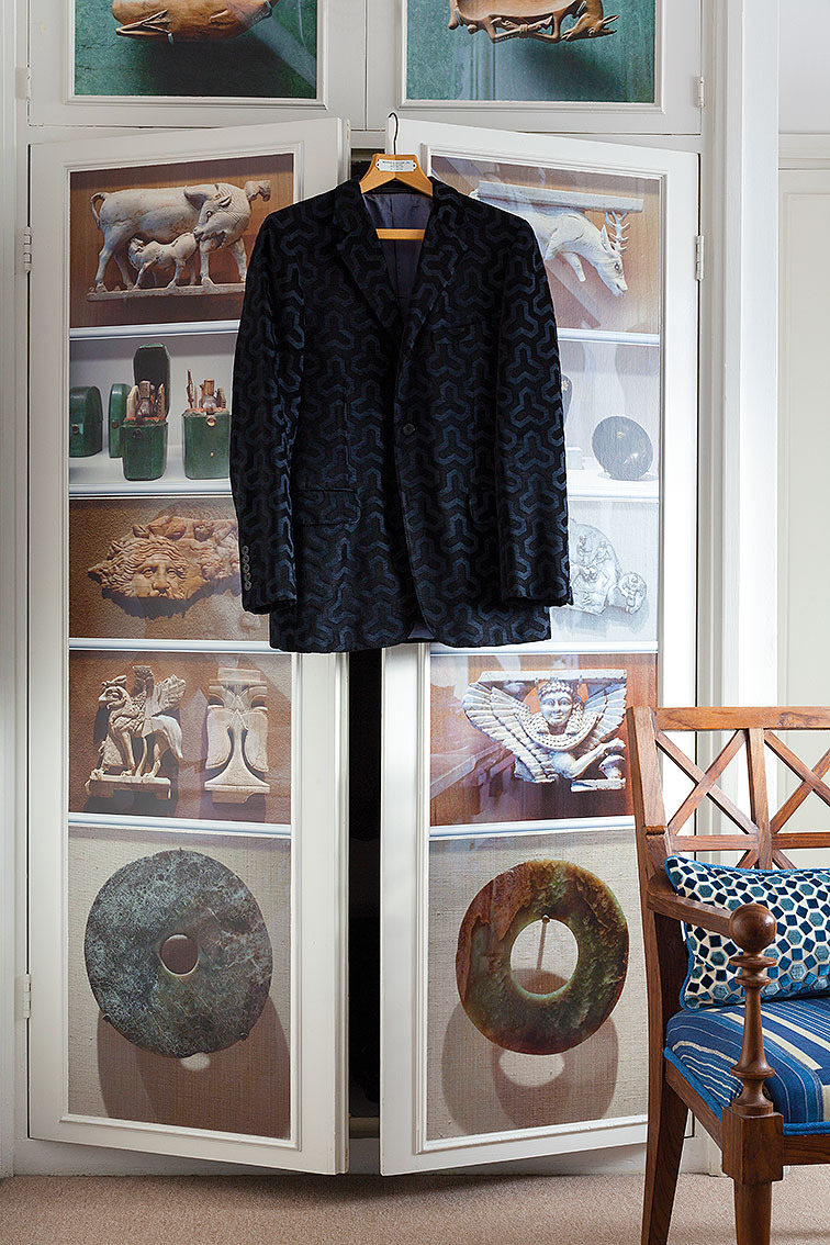 BEDROOM     My Tom Ford for Gucci jacket, inspired by my father's iconic print, on one of the faux museum wardrobes.
