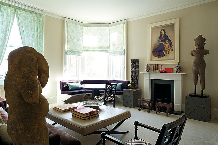 LIVING ROOM To the light, airy living room of this apartment, watched over by an old stone Ganesh, I added a corner banquette around my octagonal dining table, with cushions in a deep purple and turquoise, colours taken from the sari in the Claudio Bravo portrait, which I framed in vellum.