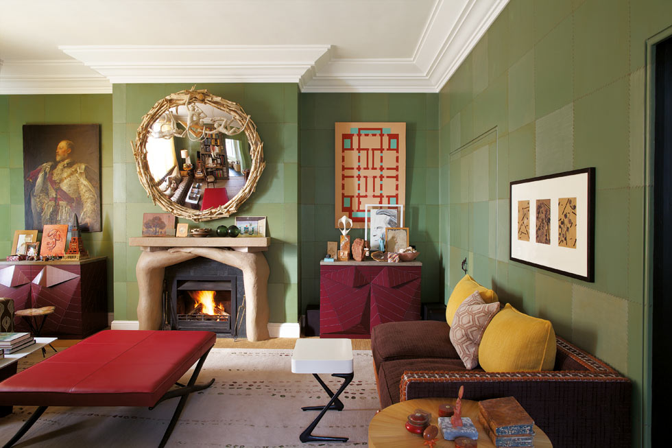 LIVING ROOM     The walls give this room a warm, cosy feeling, painted to resemble stitched squares of sage green leather. I made both the 'Brothers' chimneypiece in painted plaster and the convex mirror above it, a playful version of the elegant Regency ones with gilded eagles; on mine, a trio of cheeky monkeys play with architect's tools on the frame of bleached sticks.