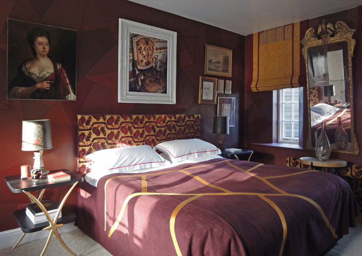 BEDROOM     The bedside tables are my  Crescent    design with gilded legs. The headboard is in my David Hicks  Topkapi Tulip    velvet, its colours very like those of the 1750 chair in the photograph, above it, that I took at Stupinigi, the beautiful Baroque hunting-lodge near Turin.