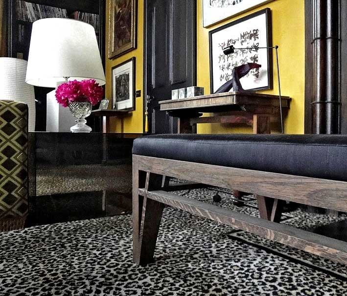 DRAWING ROOM In front of the fire, a bench I designed in dark-stained oak, covered in black horsehair woven by John Boyd in Somerset, not so far away, and a table of bronze smoked Perspex, both sitting happily with the Regency sofa-table against the wall, and the leopardskin carpet.