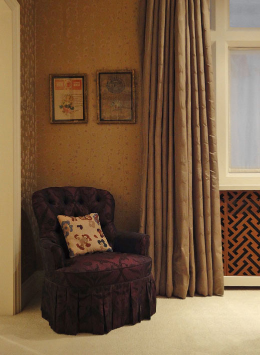GUEST ROOM The radiator cover with tan leather panels sits well with a deep-buttoned chair in my David Hicks by Ashley Hicks Angelica Trellis flocked silk.