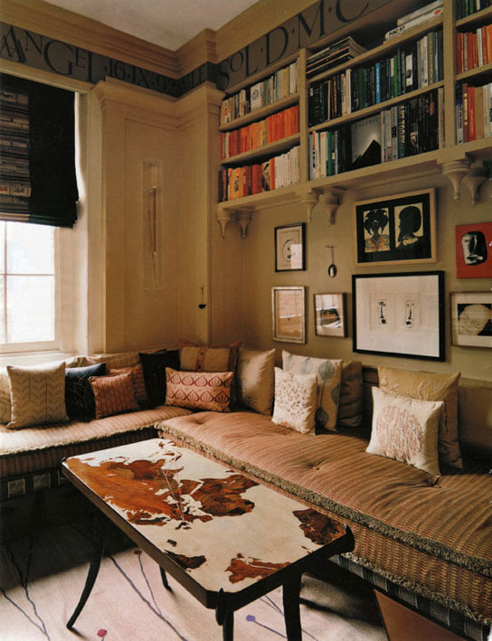LIBRARY Two sides of this very small, intimate room had an L-shaped seat, thick mattresses edged in moss fringe, on open oak bases laced with upholsterer's webbing, below which was space for leather baskets for storage. The roman blind was made from a Sumatran wedding skirt.