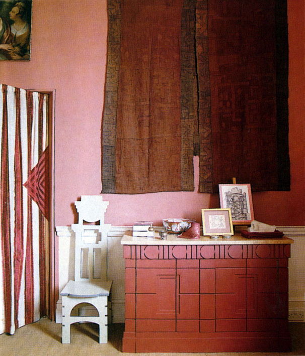 STUDIO The entrance door was draped with an Indian Bagh embroidery; on the wall was a rare madder-dyed Kuba appliqué cloth. We got all these antique textile treasures from Joss Graham. The very architectural, red cabinet held TV and stereo.