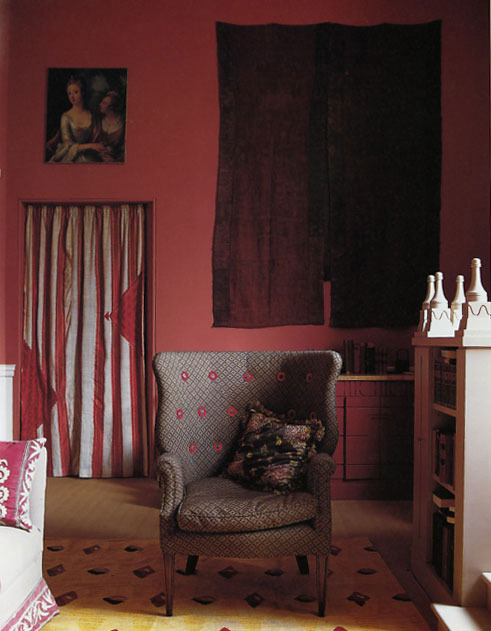 STUDIO I painted the walls a Victorian Etruscan red, and covered the client's own wing chair in a small weave, with buttons mounted on rosettes of red felt which earned it the nickname Memorial Manas they looked like poppies. I gave the window seat Soanesque, turned finials with incised wavy lines.