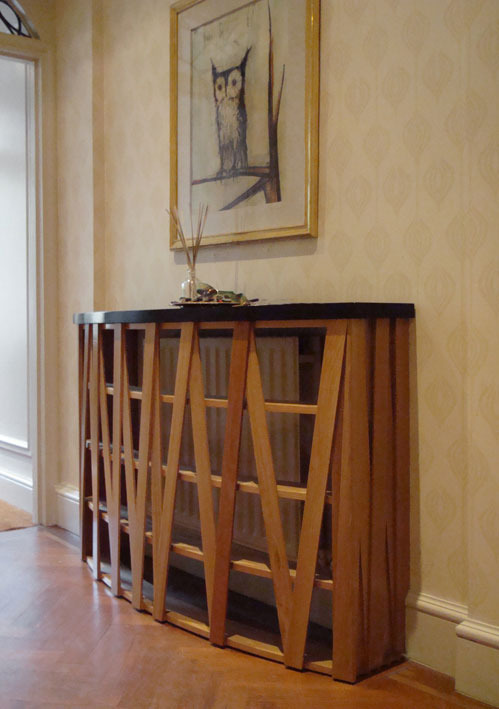 CHELSEA HALL TABLE In this Chelsea hall, I made a shallow bow-fronted console of open oak slats in a Random Ribbon pattern to both screen the radiator and give my clients room for their keys, post and so on.