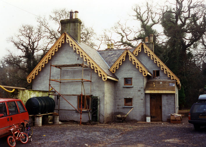 THE COTTAGE I was asked to design a house for a young family, extending this small Victorian gingerbread cottage in a wooded setting in Ireland. When I arrived, they had started work with a local architect who had drawn up plans and begun work on the cottage, adding the haphazard extensions and tiny square windows seen here.