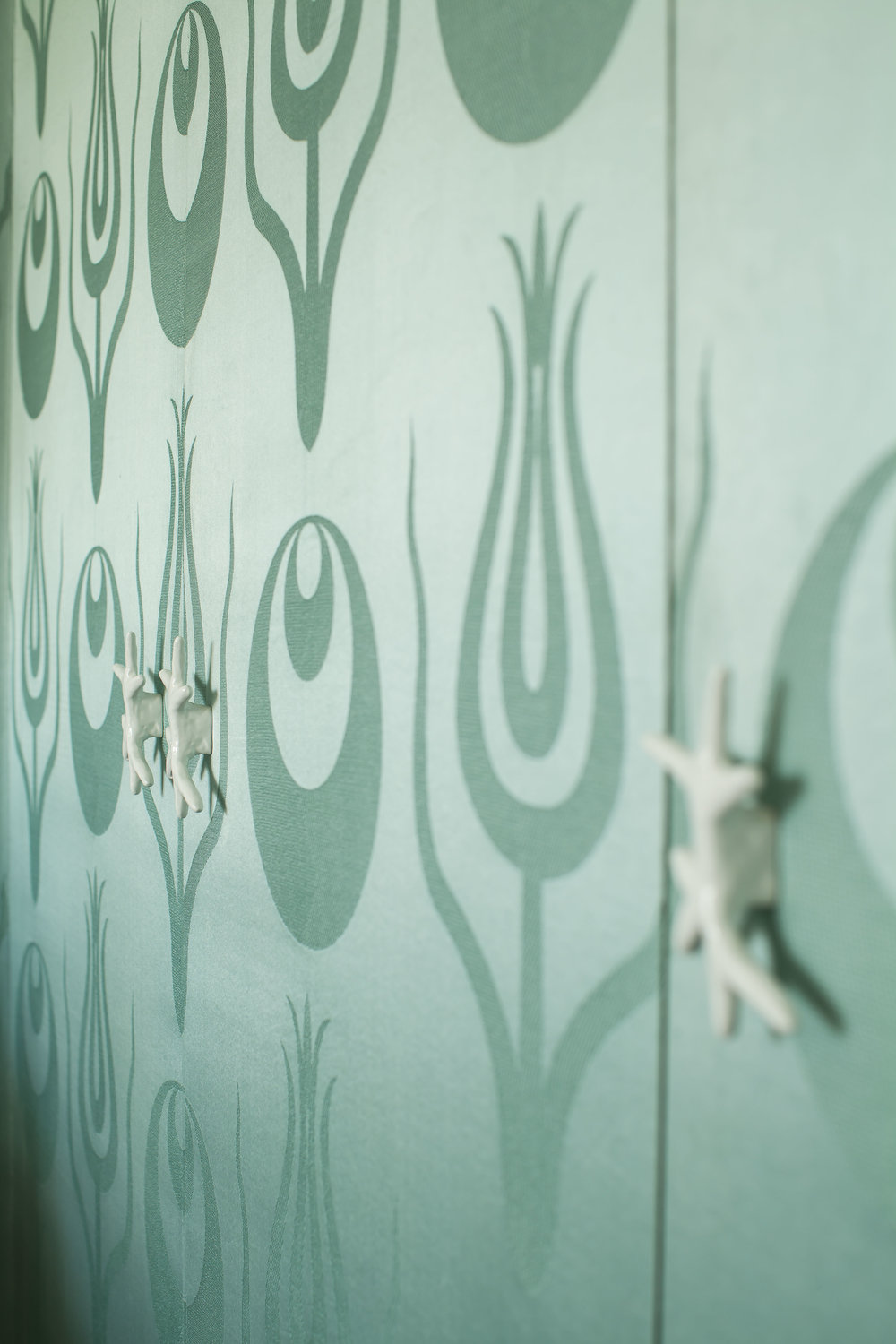 CLOSET DOORS Adorned with Ashley's white lacquer coral handles