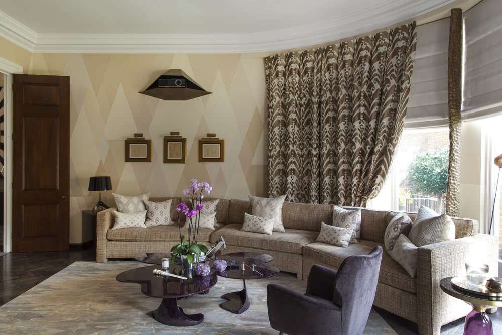LIVING ROOM Featuring walls hand-painted by Ashley with flesh-toned trapezoidal shapes.