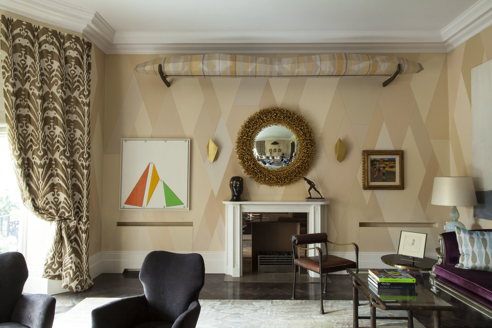 DRAWING ROOM Featuring walls hand-painted by Ashley with flesh-toned trapezoidal shapes.
