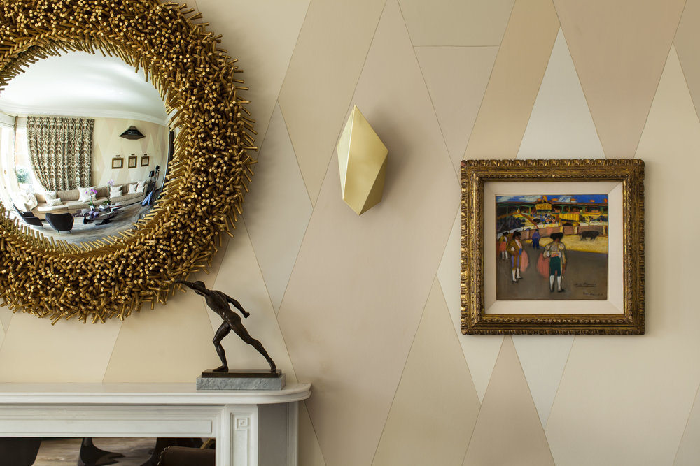 LIVING ROOM DETAIL Featuring walls hand-painted by Ashley with flesh-toned trapezoidal shapes.