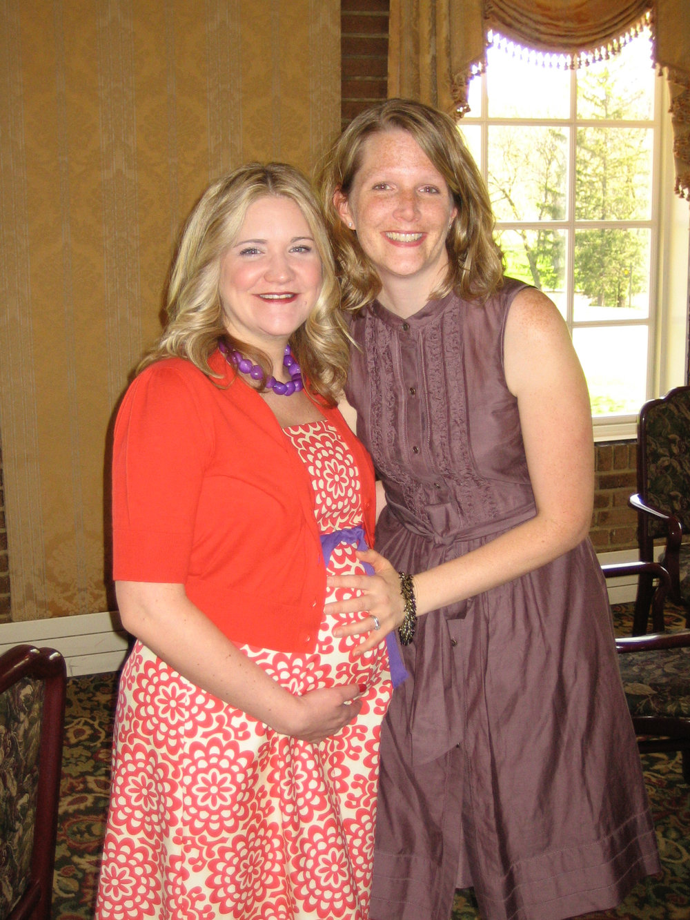 This is Katrina pregnant with Maddox at the awesome baby shower Marcy threw at Medinah. Marcy looks so cute here with her freckles! I am trying to be cute by am actually miserable with horrendous back pain, but man, that is an adorable maternity outfit!