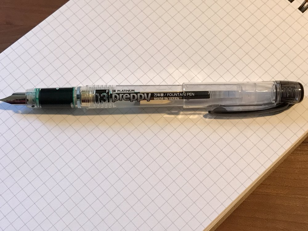 Silver nib, black pen stylings.