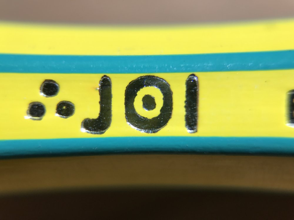 Joi logo on both pencils.