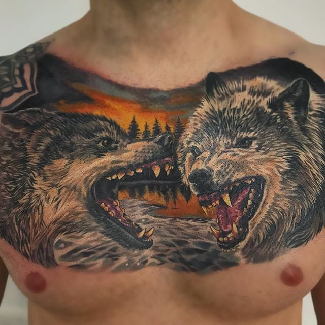 Finished up Gareth's wolf chest piece today! Wolves healed, background fresh. #tattoo #realismtattoo #colourtattoo #realism #hyperrealism #uktta #skinartmag #skinart_healed #totaltattoo #eternalink #ttechneedles #easytattoo