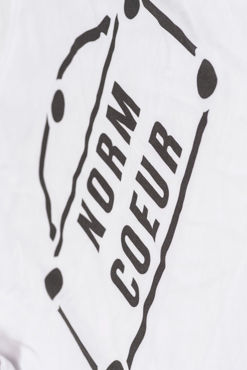 Tee-Blanc-Norm-Coeur-Floriane-Fosso-Detail.jpg