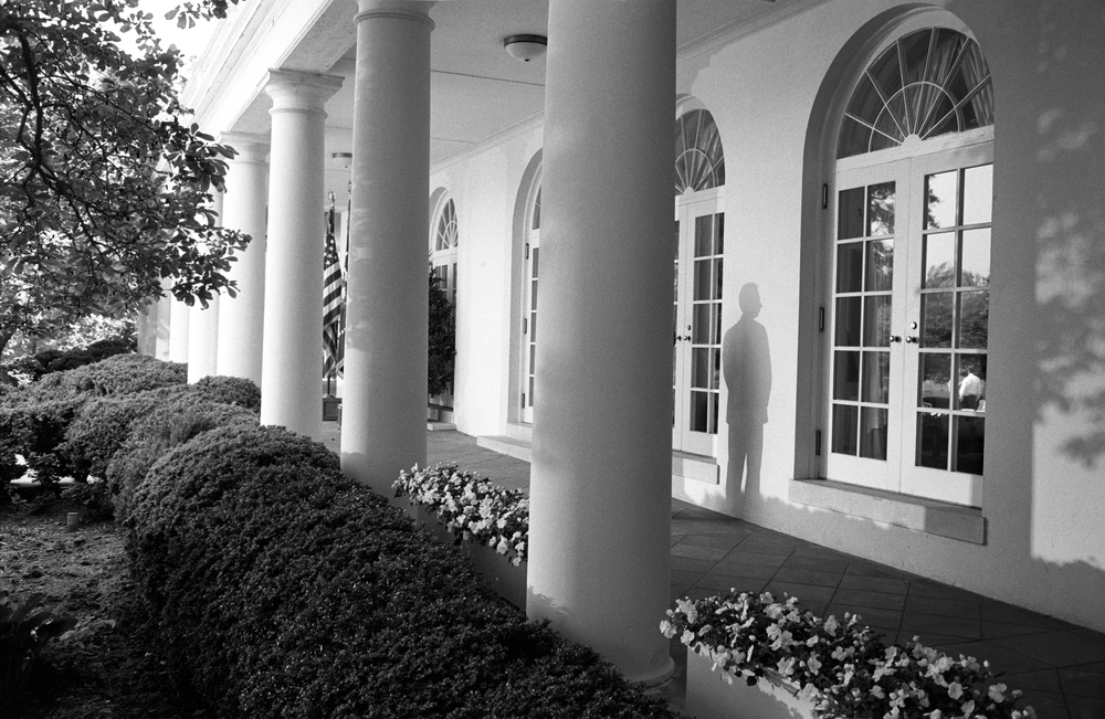5.12.99--Washington, DC--TV lights in the Rose Garden create the shadow of a PPD (Presidential Protection Division) agent in the colonnade. The President's PPD agents stand sentinel within close proximity of the President 24 hours a day, seven days a week.